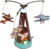 Biplane carousel. Tin Toy / retro / clockwork fairground toy