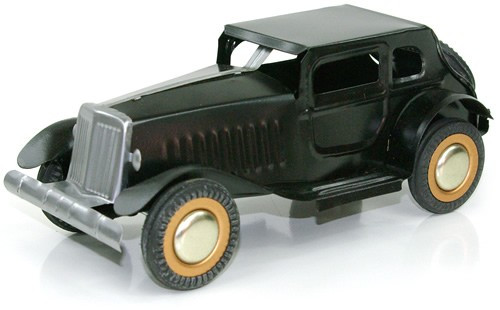 Classic Black Automobile. Tin Toy / retro / clockwork toy car