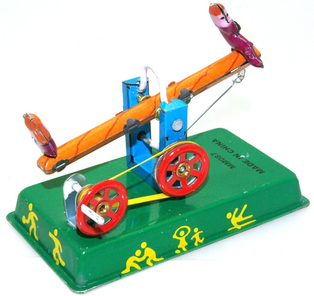 Seesaw tin toy