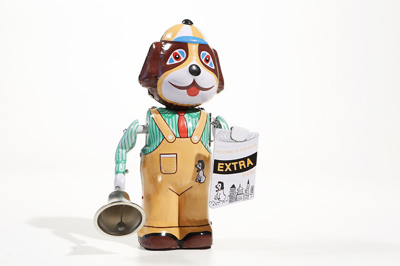 Dog with Newspaper and Bell