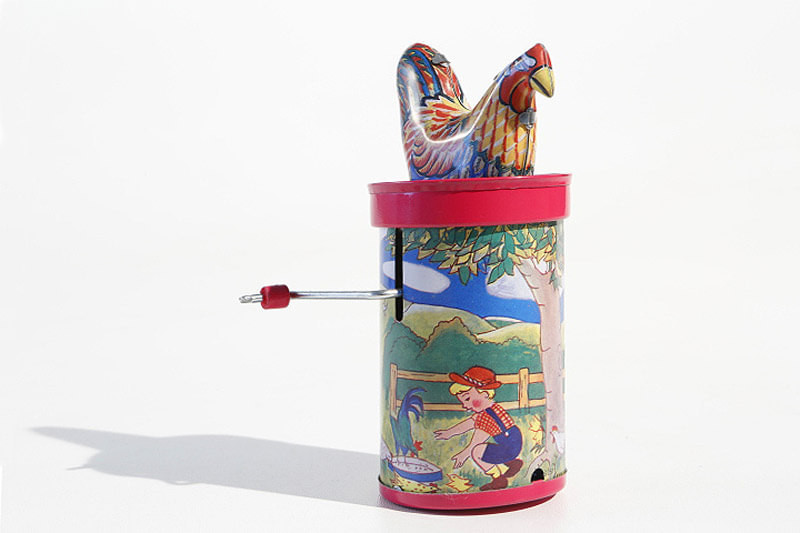 Clucking rooster tin toy