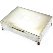 silver plated playing card box with 4 legs.
